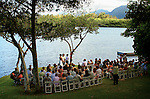 The wedding of Kim and Joalyn commences before family and friends at Moli'i Pond about Kualoa Regional Park on the east end of Oahu.