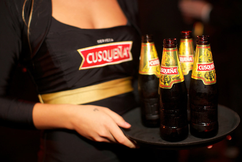 New York, NY - October 27, 2014: Peruvian beer, Cusque&ntilde;a served at Gallow's Green at an afterparty for the International Chefs' Congress hosted by StarChefs. Visiting chefs from Peru prepared passed snacks for the party.<br /> <br /> CREDIT: Clay Williams for StarChefs.<br /> <br /> &copy; Clay Williams / claywilliamsphoto.com
