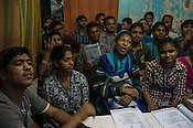 Deaf students react while attending speech classes at the Noida Deaf Society in Noida, Uttar Pradesh, India.