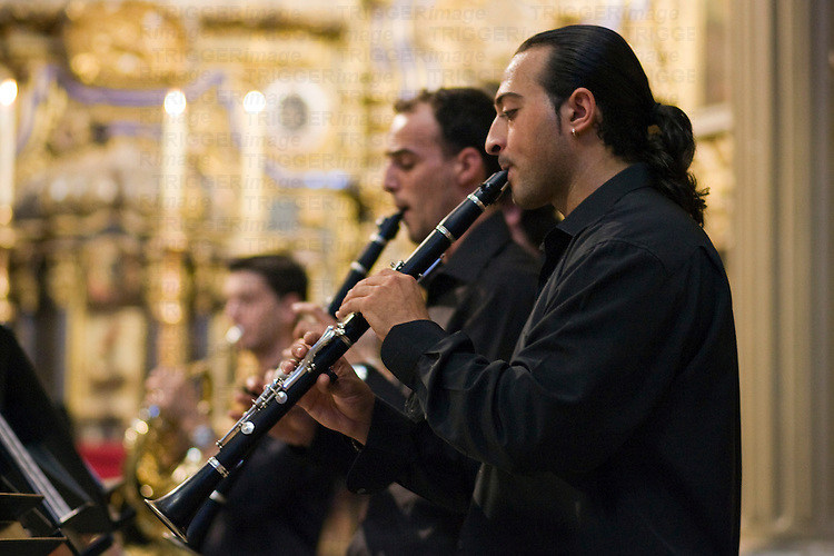 Wind ensemble members playing in San Luis de los Franceses church, Seville, Spain