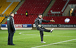 St Johnstone v Aberdeen...13.12.11   SPL .Goal keeping coach Alan Combe kicks a ball to test the wind watched by ref Steven McLean.Picture by Graeme Hart..Copyright Perthshire Picture Agency.Tel: 01738 623350  Mobile: 07990 594431