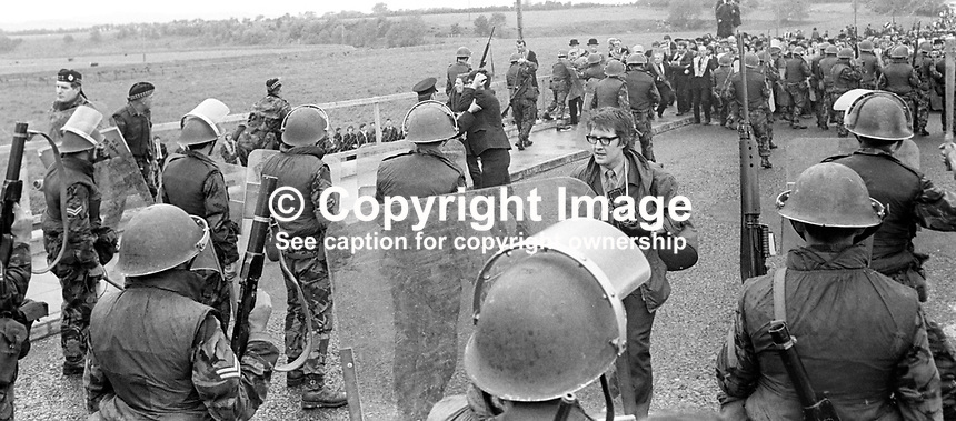 British soldiers halt an Orangemen's parade defying a N Ireland Government parade ban preventing them marching in Dungiven, Co Londonderry, UK,  Dungiven is a strongly republican town and if the parade had proceeded would almost certainly have led to serious clashes. Picture includes Londonderry photographer Trevor McBride.  Ref: 19710613220c<br />