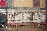 Remains of tile work are seen on the exposed wall of a building adjacent to a construction site in Chelsea in New York on Friday, April 17, 2015. (© Richard B. Levine)