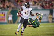 Tampa, FL - September 4th, 2016: Towson Tigers wide receiver Dillon Tighe (13) evades a defender during a kick return during game against USF at Raymond James Stadium in Tampa, FL. (Photo by Phil Peters/Media Images International)