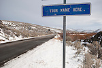 """Sign for """"Your Name Here"""" under litter control along the highway. SR 225, Mountain City Highway in northern Nev."""