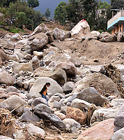 A girls picks her way among rocks in Piedra Grande, a small village near San Marcos, Guatemala, where 52 people were killed and six others went missing in five minutes on October 5 when a landslide tore through the village, leaving many boulders in its wake. Townspeople said no one from governmental or non-governmental agencies has visited the town since the disaster. Torrential rains associated with Hurricane Stan inundated parts of Central America in early October, causing flooding and mudslides across western Guatemala.<br />