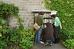 Young festival goers select 50p books from The Garden Book Shop. The Hay Festival, Hay on Wye, Powys, Wales, Great Britain. 2006.