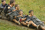 Jodi Miller.Kids from Washington state Boston made the most of a rainy day at the Little League World Series by sliding down the muddy hill in trash bags. All games were postponed Monday.
