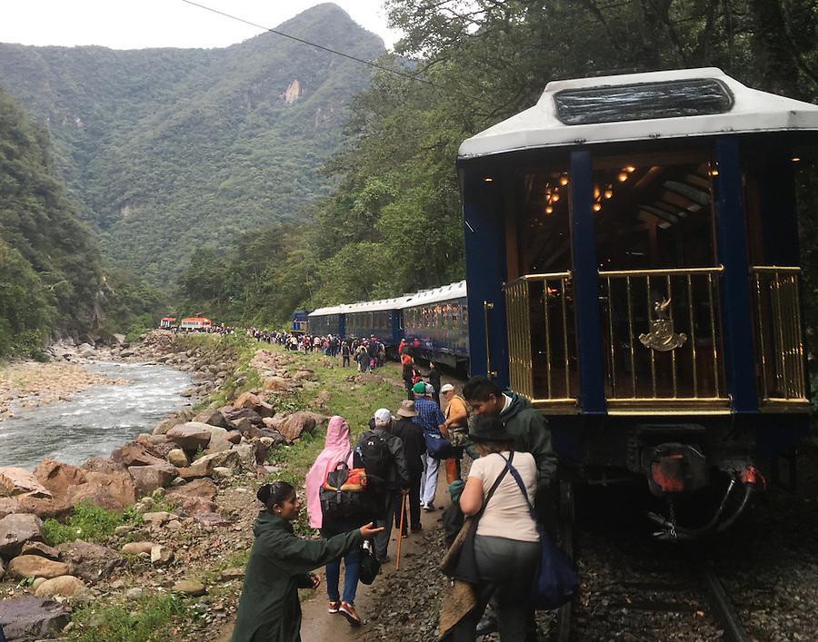 CUSCO, PERU - CIRCA OCTOBER 2015:  Inca Rail Trains and tourists close to Ciudad Machu Picchu