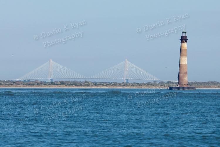 Arthur Ravenel Jr Bridge and Morris Island Lighthouse on the Atlantic ocean near Charleston South Carolina