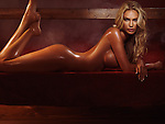 Beautiful nude woman with long blond hair lying naked on a steam room bench artistic erotic photo