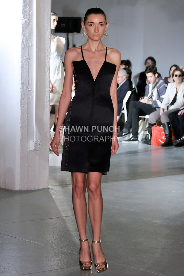 Model walks runway in an outfit by Ruby Gertz, for the 2012 Pratt Institute fashion show, at Center548 NYC, on April 26, 2012.
