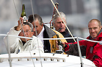Spectators and a bag-piper brave the wind at the Wellington restart of Round North Island two-handed yacht race. Wellington, New Zealand. 2 March 2011. Photo: Gareth Cooke/Subzero Images