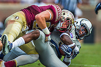 TALLAHASSEE, FLA 9/10/16-Florida State's Jared Jackson tackles Charleston Southern's Brandon Rowland during a second quarter kick off return, Saturday at Doak Campbell Stadium in Tallahassee. <br /> COLIN HACKLEY PHOTO