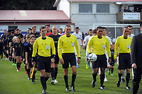 The match officials lead the teams out for the Oceania Football Championship final (second leg) football match between Team Wellington and Auckland City FC at David Farrington Park in Wellington, New Zealand on Sunday, 7 May 2017. Photo: Dave Lintott / lintottphoto.co.nz