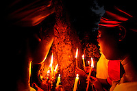 HAITI, Cap Haitien, July 23, 2006..Believers attend Voodoo ceremonies in Cap Haitien,  July 23, 2006. VIEWpress / Eduardo Munoz Alvarez..The principal belief in Haitian Vodou is that deities called Lwa (or Loa) are subordinates to a god called Bondyè. This supreme being does not intercede in human affairs, and it is to the Lwa that Vodou worship is directed. Other characteristics of Vodou include veneration of the dead and protection against evil.