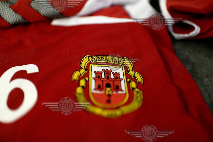 The crest on a shirt belonging to the Gibraltarian under-17 national team. Although the United Nations doesn't recognise Gibraltar as an independent country, UEFA has recognised it and has granted the British Overseas Territory full UEFA membership.