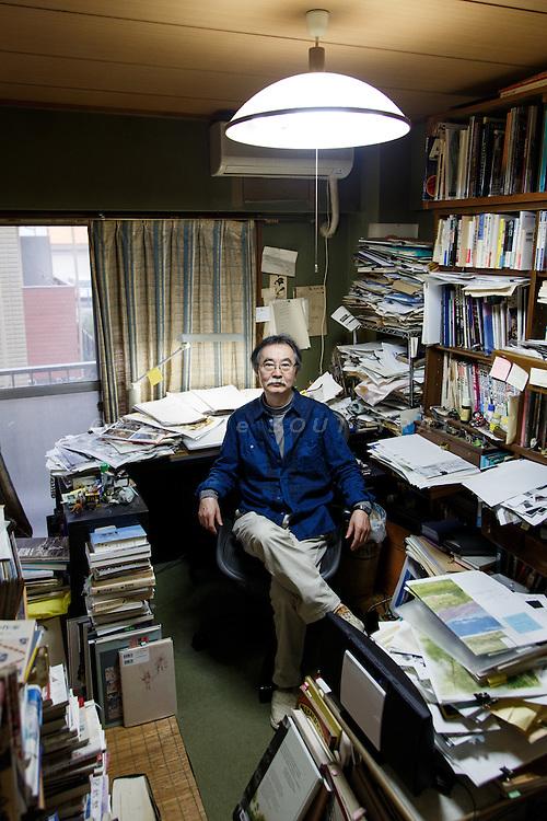 Tokyo, November 9 2014 - Portrait of the manga artist Jiro Taniguchi in his atelier.