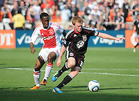 DC United midfielder Dax McCarty (10)  shields the ball against AFC Ajax defender Vurnon Anita (5)   AFC Ajax defeated DC United 2-1 during an International Friendly at RFK Stadium Sunday May 22, 2011.