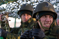 Kamenka, Karelia, Russia, 14/12/2007..Professional Russian soldiers in action in their command post during Snezhinka [Snowflake] 2007, a joint live fire training exercise for Russian and Swedish motorised infantry in which they play the roles of a combined peace-keeping force enforcing a demilitarised zone in a warring region.