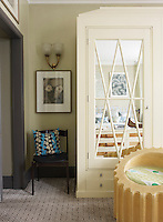 A free-standing wardrobe with mirrord doors occupies one wall of the master bedroom