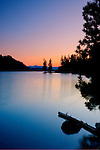 Idaho, North, Kootenai County, Coeur d'Alene. Twilight reflects in the calm water of Fernan Lake on a spring evening.