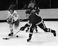 Seals vs LA Kings 1975. Kings Sheldon Kannegiesser shoots past Seals Jim Moxey. (photo/Ron Riesterer)