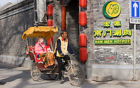 Western tourist in a rickshaw, Hutongs area, Beijing, China