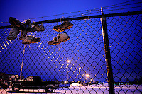 General Motors employees leave their old work shoes on the fence near the entrance to the Janesville Assembly Plant.