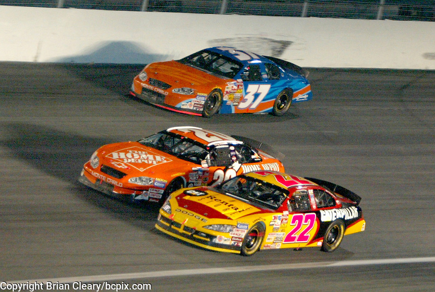 Tony Stewart, 20, Ward Burton, 22, Derrick Cope, 37, UAW-GM Quality 500, Charlotte Motor Speedway, Charlotte, NC, October 11, 2003.  (Photo by Brian Cleary/bcpix.com)