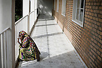 BUKAVU, DEMOCRATIC REPUBLIC OF CONGO - OCTOBER 30: An unidentified woman sits outside a ward as she is recovering from surgery at Panzi hospital outside Bukavu, DRC. Many of the women in the hospital has been raped and abused by rebels and government soldiers. About 10 women and girls show up at the hospital every day. (Photo by: Per-Anders Pettersson).