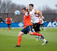 Jake Pace (20) of Maryland has the ball cleared away from him by Kevin McBride (15) of Virginia during the ACC Finals at the Maryland SoccerPlex in Boyds, MD.  Maryland defeated Virginia, 1-0, to win the title.