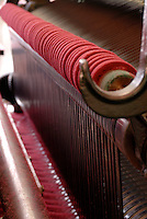 Close up of one of the looms and a stage in the preparation of the felt