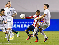 CARSON, CA - July 7, 2012: Chivas USA midfielder Paolo Cardozo (30) and Vancouver Whitecaps midfielder (4) during the Chivas USA vs Vancouver Whitecaps FC match at the Home Depot Center in Carson, California. Final score Vancouver Whitecaps FC 0, Chivas USA 0.