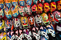 Colorful Lucha libre (Mexican wrestling) masks for sale on a stall at a local arena in Mexico City, Mexico, 29 May 2011. Lucha Libre, 'free wrestling', is a unique Mexican sporting event characterized by the use of colorful masks. Masks (máscaras) have been a part of Lucha Libre since its inception in the early 20th century. The use of the masks in wrestling is related to the Aztec civilization and culture. In modern lucha libre, masks play an important part of the fight storyline, they are colorfully designed to evoke the images of animals, gods, ancient heroes, and other archetypes, whose identity the wrestler takes on during the fight.