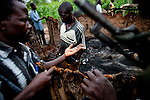 Patrolling &quot;arrow boys&quot; inspect a house burnt down by the LRA outside of Tambura on May 23, 2010. The &quot;arrow boys&quot; are a self defence force that hs sprung up in Western Equatoria to defend against the LRA.