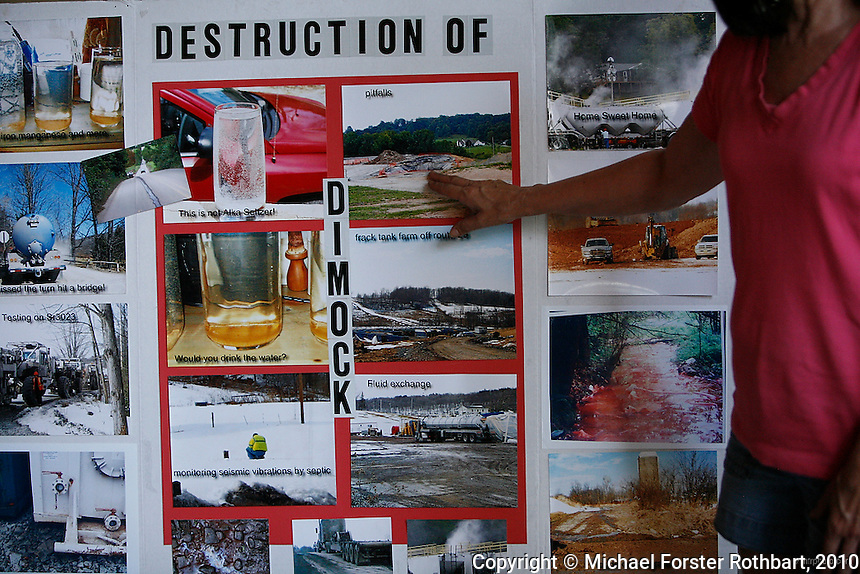 In Dimock, PA, Victoria and Jimmy Switzer are among 14 families along Carter Road whose drinking water wells became contaminated with methane and other chemicals after gas drilling on their properties. Cabot Oil and Gas, the company held responsible by the Pennsylvania Department of Environmental Protection, has had at least 21 spills in Dimock township in less than two years. <br /> <br /> &quot;Here we're in the middle of three wells,&quot; says Victoria Switzer, &quot;710 feet this way, 1435 feet up the hill and 1375 feet there. And that's pretty much how it plays out. There's no spacing regulations.&quot; Despite not being able to drink their water and a pending lawsuit against Cabot, the Switzers have continued to build their new family home and plan to stay.<br /> <br /> Hydraulic fracturing or &quot;fracking&quot; is new method of drilling for natural gas: millions of gallons of water, sand and proprietary chemicals are pumped down a well under high pressure. The pressure fractures the shale, opening fissures so that natural gas can flow more freely. In August 2010, fracking is being widely used in the Marcellus Shale formation under Pennsylvania while New York considers a moratorium until the environmental effects can be reviewed. <br /> <br /> The 2005 Energy Policy Act exempted natural gas drilling from the Safe Drinking Water Act. Scientists have identified volatile organic compounds (VOCs) such as benzene, ethylbenzene, toluene, methane and xylene that have been found in contaminated drinking water near drilling sites. On the other hand, gas companies and property owners stand to earn up to one trillion dollars in profits from drilling in the Marcellus Shale.<br /> <br /> &copy; Michael Forster Rothbart<br /> www.mfrphoto.com <br /> 607-267-4893 o 607-432-5984<br /> 5 Draper St, Oneonta, NY 13820<br /> 86 Three Mile Pond Rd, Vassalboro, ME 04989<br /> info@mfrphoto.com<br /> Photo by: Michael Forster Rothbart<br /> Date: 8/2010    File#:  Canon 5D digita
