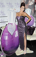 Amy Childs.The photocall to launch her debut fragrance in collaboration with Jigsaw, Aura bar & nightclub, London, England..August 15th, 2012.full length purple strapless dress slit split sequins sequined hair up bun silver sandals shoes hand on hip.CAP/CAN.©Can Nguyen/Capital Pictures.