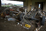 An upturned car, tractor and medical apparatus remain among the sludge of a clinic near Okawa Elementary School in the Kahoku district of Ishinomaki, Miyagi Prefecture, Japan on 08 Sept. 2011.  Photograph: Robert Gilhooly