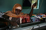 A patient at the Kwali Rehabilitaion Center in Kano practices the usage of a knitting machine. The women at the center are recovering from surgery to eliminate a condition known as fistula and waiting to be returned and re-integrated to their home communities. The center also tries to teach them basic skills such as literacy and knitting and sewing. Imbruglia and UNFPA, the United Nations Population Fund, are working to bring awareness to obstetric fistula, a devastating injury of childbirth that affects more than two million women in developing countries, particularly Nigeria where half of known cases are found. The condition, caused by damage to the walls of the vagina during protracted labor, usually leads to the death of the child and leaves affected women incontinent and often disowned by their husbands and communities.