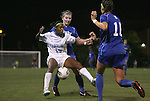 13 October 2011: North Carolina's Crystal Dunn (19) is defended by Duke's Alex Straton (behind) and Laura Weinberg (16). The University of North Carolina Tar Heels defeated the Duke University Blue Devils 1-0 at Fetzer Field in Chapel Hill, North Carolina in an NCAA Division I Women's Soccer game.