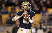 PITTSBURGH, PA - NOVEMBER 05:  Tino Sunseri #12 of the Pittsburgh Panthers drops back to pass against the Cincinnati Bearcats on November 5, 2011 at Heinz Field in Pittsburgh, Pennsylvania.  (Photo by Jared Wickerham/Getty Images)