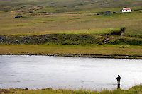 Atlantic Salmon Catch and Release Fly Fishing in Iceland. Fly fisherman in Skipahylur pool Sela, Vopnafjordur
