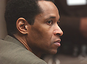 Sniper suspect John Allen Muhammad listens to testimony during his trial in courtroom 10 at the Virginia Beach Circuit Court in Virginia Beach, Virginia on October 30, 2003. <br /> Credit: Adrin Snider - Pool via CNP