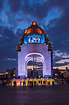 In Plaza de la Republica colorful water fountains silhouette people in front of the art deco inspired Monument to the Revolution.  The landmark commemorates the Mexican Revolution and is considered the tallest triumphal arch in the world.
