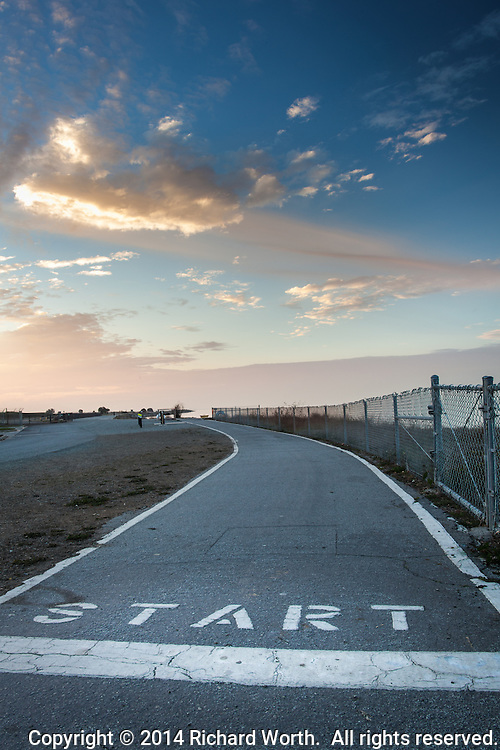 """The """"start"""" of a section of the San Francisco Bay Trail that is marked off in quarter mile segments.  South of the Marina Park in San Leandro, California."""