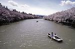 Boaters get a close up view of cherry blossom trees lining the banks of a river at the Cherry Blossom Festival held in Oyo Park near Hirosaki Castle in Aomori Prefecture in Northern Honshu, Japan. Over 1500 cherry trees come into bloom from late April to Early May. (Jim Bryant Photo).....