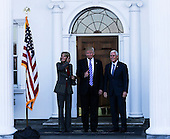 United States President-elect Donald Trump (C) and Vice President-elect Mike Pence (R) pose with Betsy DeVos at the clubhouse of Trump International Golf Club, November 19, 2016 in Bedminster Township, New Jersey. <br /> Credit: Aude Guerrucci / Pool via CNP
