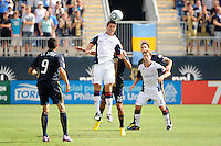 Chris Tierney (8) of the New England Revolution heads the ball. The Philadelphia Union and the New England Revolution  played to a 1-1 tie during a Major League Soccer (MLS) match at PPL Park in Chester, PA, on July 31, 2010.