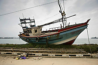 A fishing boat on the side of the road in Galle after the tsunami struck on the 26th of December 2004.